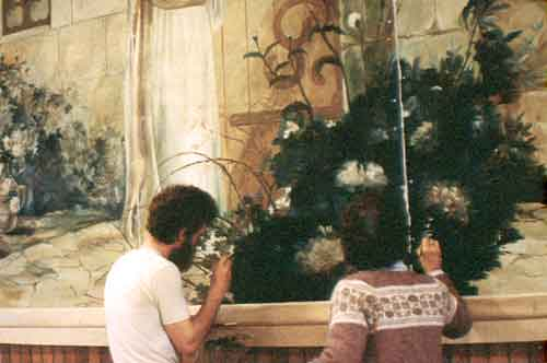 Art Zoller Wagner and Honnie Wagner restoring a painting by Emilio Fernández, Christ Knocking at Heart's Door