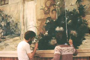Art Zoller Wagner and Honnie Wagner restoring a painting by Emilio Fernández, Christ Knocking at Heart's Door, 1993